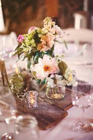 wood centerpieces 35 eco chic ways to use rustic wood pallets in your wedding deer