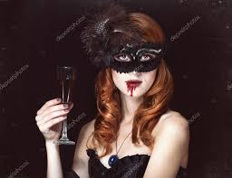 redhead vampire woman in mask with glass of blood u2014 stock photo