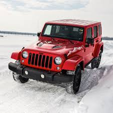 badass 2 door jeep wrangler off road in the snow with jeep