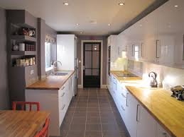great wall colour under cabinet lighting and warm wooden worktops