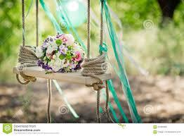 wedding decor a bridal bouquet on a decorative swing stock photo