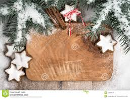 winter frame decorated with christmas tree snow and cookies stock