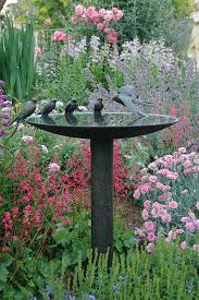 20 beautiful garden decorations sculptures accentuate garden