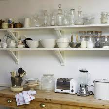 Kitchen Wall Shelving by Grouping Like Items On Open Shelves Adds Interest In The Kitchen