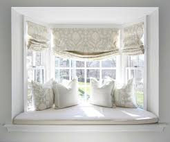 cozy up a bay window with pretty curtains an upholstered seat