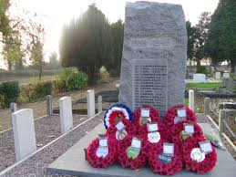 poppy wreaths left at yaxley war memorial after armistice sunday