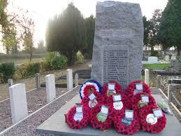 poppy wreaths left at yaxley war memorial after armistice sunday