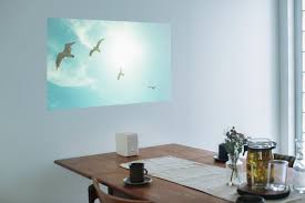 Projector In Bedroom 6 Reasons To Choose A Projector Instead Of A Tv Apartment Therapy