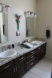 contemporary full bathroom with complex granite u0026 raised panel in
