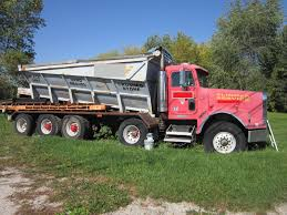 used stone spreader trucks available for sale