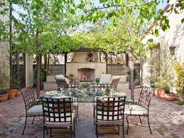 charming mediterranean dining area using traditional outdoor