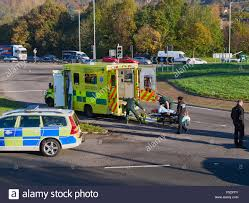 a wales ambulance and police car at the scene of a road accident