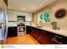 modern kitchen with white countertops white and brown new norma