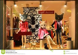 fashion boutique display window with mannequins store sale window