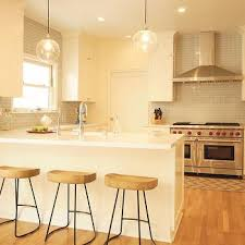 Ivory Colored Kitchen Cabinets Blue Kitchen Cabinets With White Mini Brick Tile Backsplash