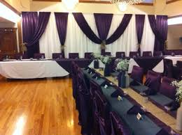 wedding backdrop linen pipe and drape backdrop in white and egg plant matching
