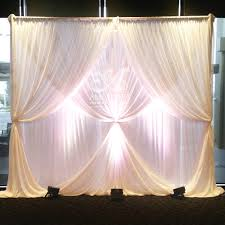 multi layered chiffon wedding backdrop with 2 layer curtain ties
