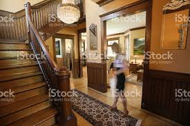 woman in entryway foyer of renovated restored victorian home