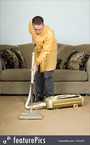 Vaccuming Picture Of Man Vacuuming The Carpet