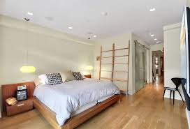 contemporary master bedroom with hardwood floors by the corcoran