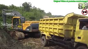 volvo diesel trucks dump truck mitsubishi colt diesel 120ps being loaded by volvo