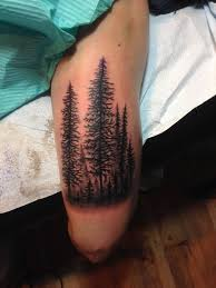 forest trees tattoos on thigh by joshua dobbs