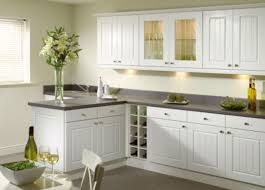 White Backsplash Tile For Kitchen Small Minimalist Kitchen With Solid Black Countertop And White