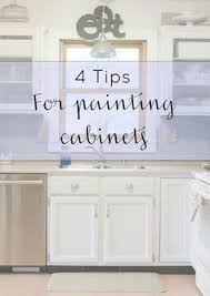 tips for painting cabinets how to paint melamine kitchen cabinets kitchens melamine cabinets