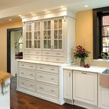 kitchen with glass doors fieldstone cabinets for a traditional kitchen with a vaulted