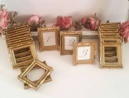 gold wedding table numbers weddings11 gold ornate framed table numbers table numbers gold