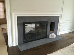 the fireplace surrounds are flamed finish absolute black granite and pietra cardosa stone if you