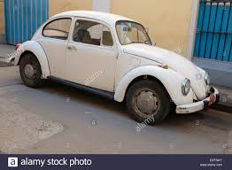 yellow volkswagen beetle royalty free a vw beetle in old havana cuba stock photo royalty free image