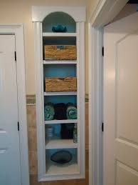 linen closet using space between studs behind tub some design