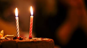 two candles on birthay cake burning in the darkness stock video