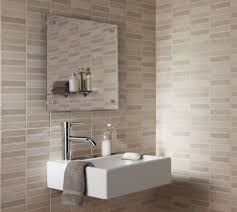 Neutral Colored Bathrooms - bathroom designed with mounted sink and ceramic tiles with neutral