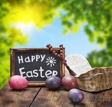 decorative eggs that open decorated with painted easter eggs and an open bible stock image
