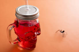 halloween storage red drink in a halloween jar with spider 9555 stockarch free