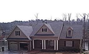 brick lake house plan with an open living floor plan