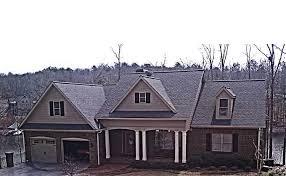 brick farmhouse plans brick lake house plan with an open living floor plan
