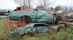 car junkyard michigan muscle car junkyard part 3 two 69 mach 1s on top of each other