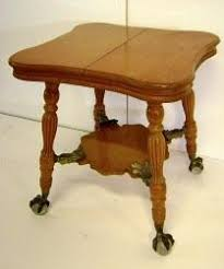 claw foot table with glass balls in the claw what a stunning piece tiger oak with glass ball claw feet east