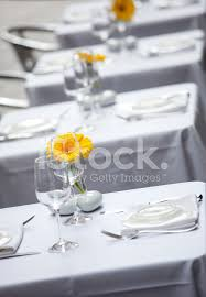 Dining Table Set Up Images Fine Dining Restaurant Table Setting With Yellow Flower Stock