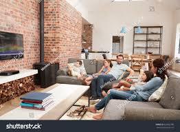 family sit on sofa open plan stock photo 627662780 shutterstock