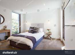 bedroom throw rug almosttacticalreviews com luxury interior designed bedroom with comfy pillows and throw rug and pendant lights luxury interior