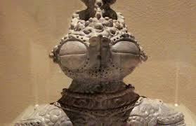 statue with ancient dogu figurines with large goggle defy scholarly