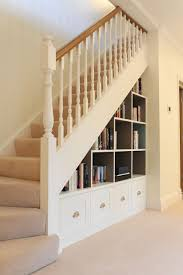 under stairs shelving 18 creative ways to use the space under your stairs basements