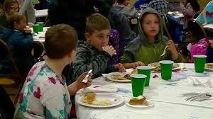 boys and club and families get early thanksgiving meal