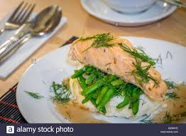 Potatoes Main Dish - roast salmon main course served with mashed potatoes and green