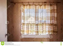 rustic window from inside the house closed by curtains stock