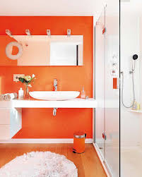 Orange Walls Colorful Small Bathroom With Orange Walls Also White Floating Sink